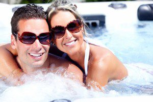 21492697 - happy couple relaxing in hot tub. vacation.